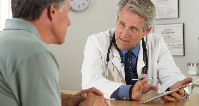 male weight loss physician talksing with male patient about losing weight and stating on the weight loss program