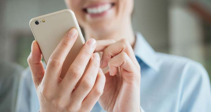 patient smiling holding phone setting weight loss appointment