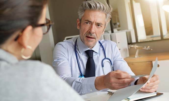 weight loss doctor discusses weight loss program with a patient in the office